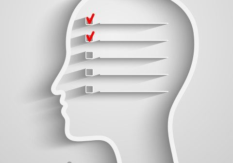 A creative concept of human memory with head and checkbox